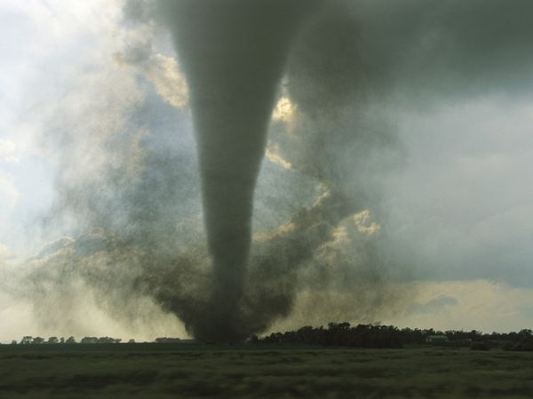 South Dakota Tornado    Photograph by Carsten Peter, National Geographic    A category F3 tornado swirls across a South Dakota prairie.