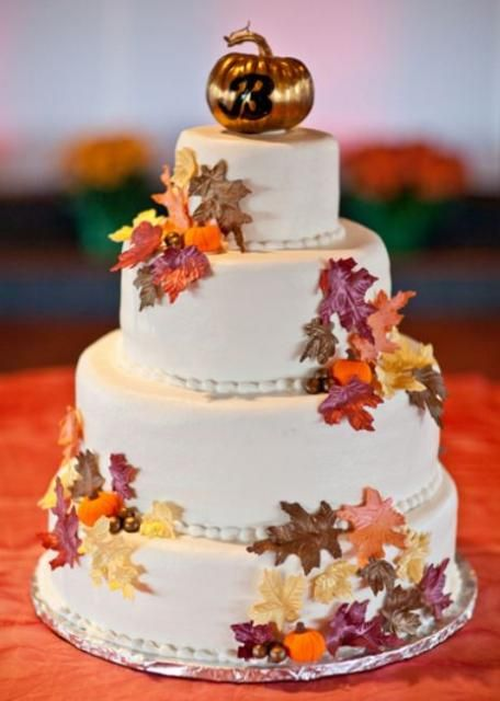 Autumn Theme 4 Tier Round Wedding Cake With Fall Foliage And Copper Pumpkin Monogram Topper