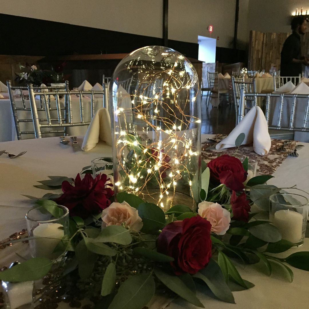 Fairytale Wedding Theme Ideas: Glass Cloche With Fairy Lights And Fresh Floral