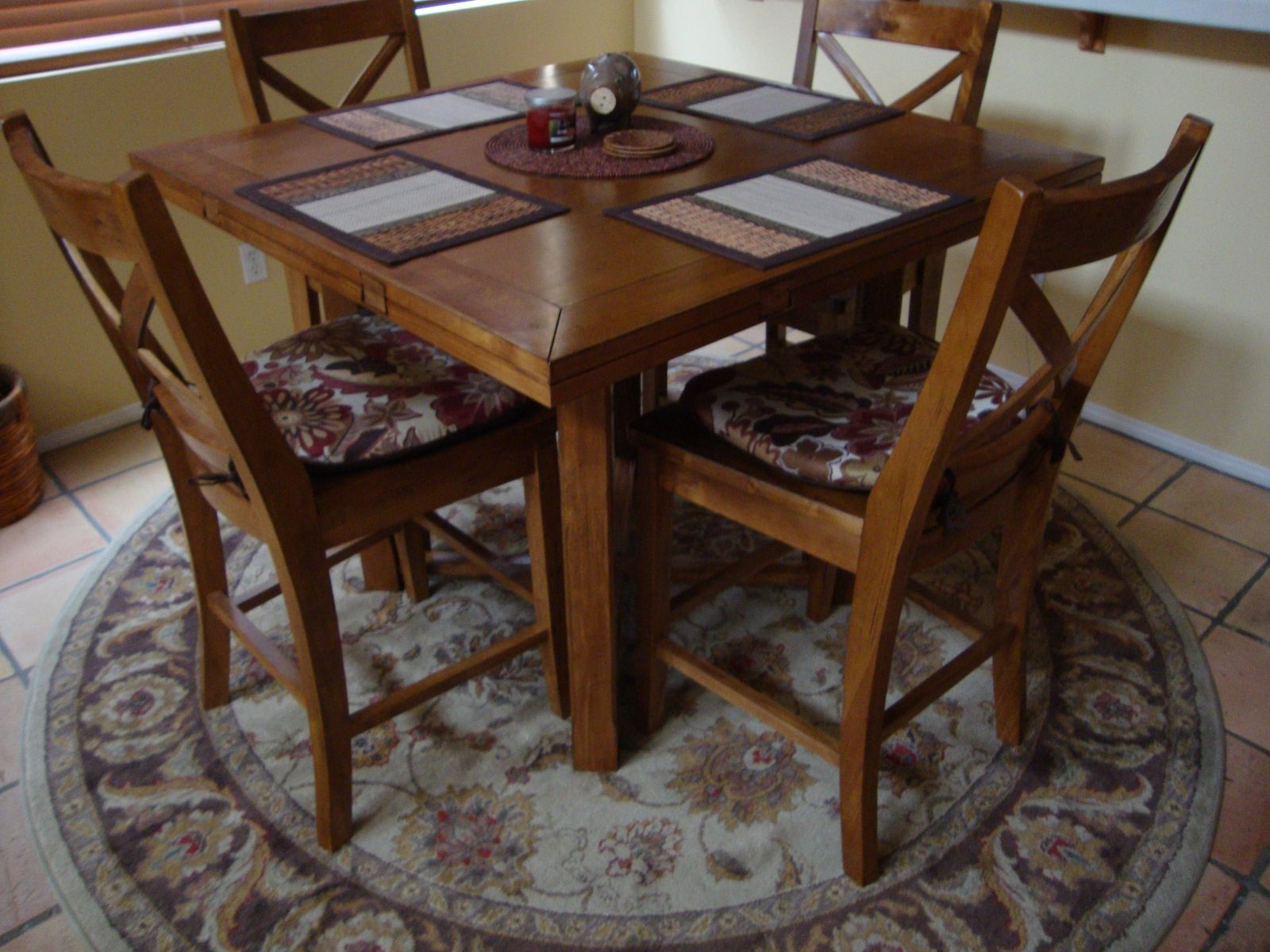 Yes a square table does go well on a round rug round for Dining table rug