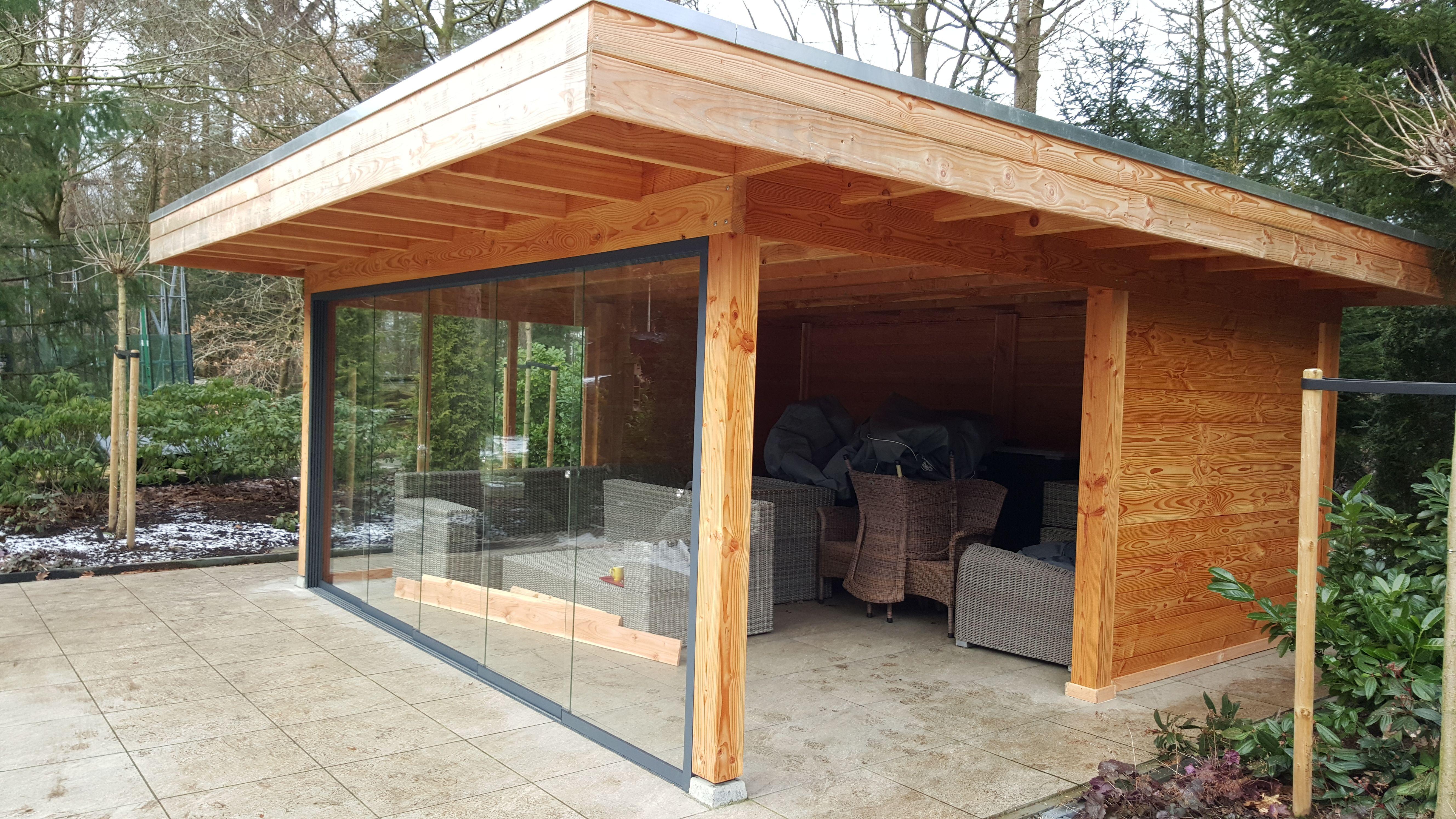 douglas houten overkapping plat dak glasschuifwand