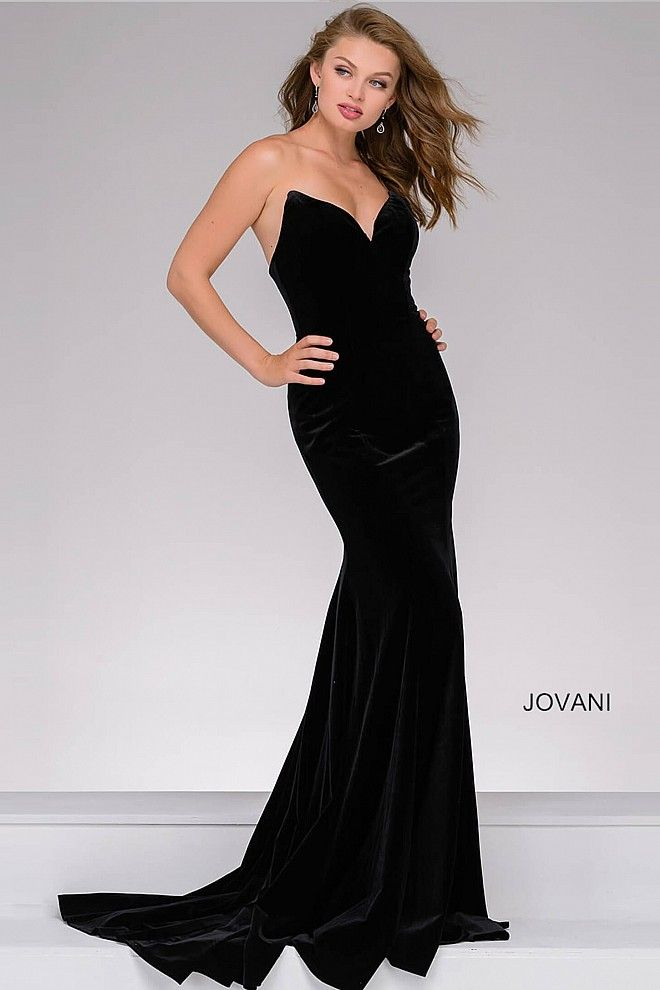 3ee362db5be4 Black floor length simple and sexy form fitting velvet dress features  strapless sweetheart neckline.