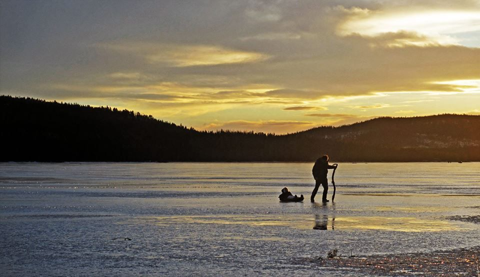 Two of our guests - father and daughter - exploring the ice on Revsund's Lake today.