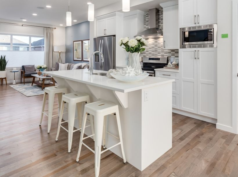 An Open Concept Floor Plan With Central Kitchen Island Be