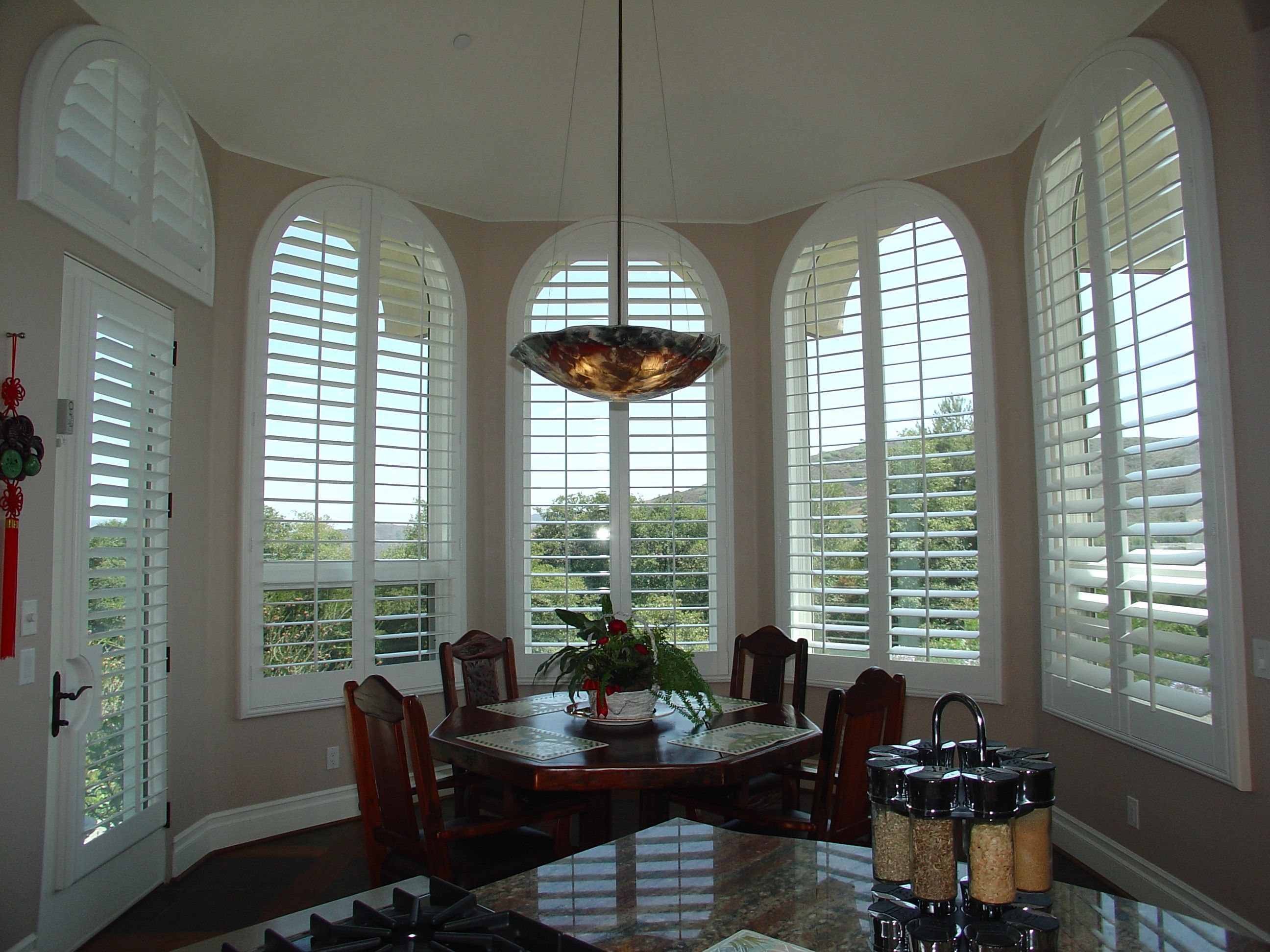 Window coverings over blinds  stunning arched plantationshutters are perfect in this beautiful