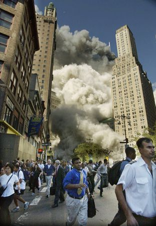 Park Row, 2001 - Pedestrians on Park Row flee the area of the World Trade Center as the center's south tower collapses following the terrorist attack on the New York landmark on Sept. 11, 2001.