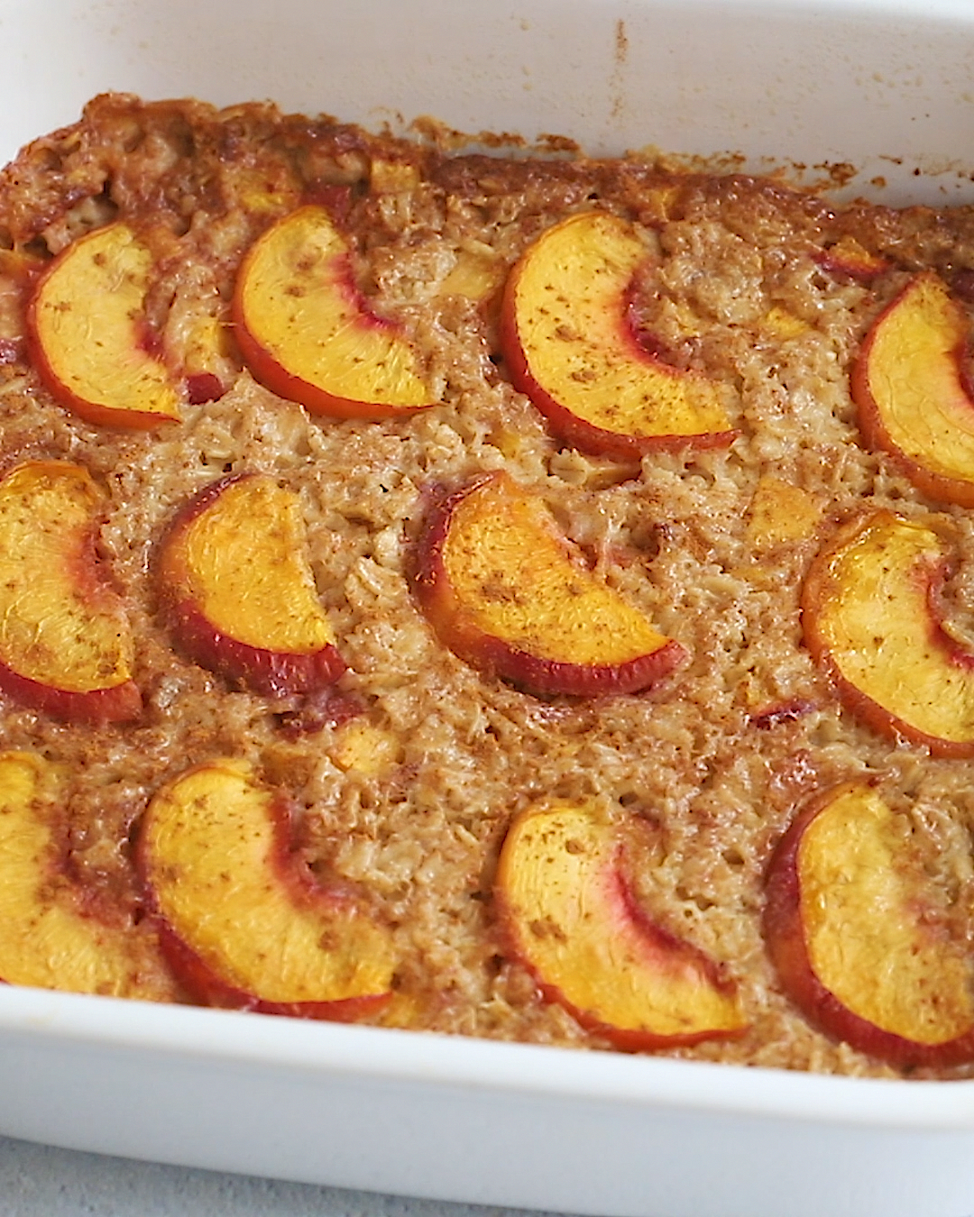 A healthy baked oatmeal recipe using one of my favorite summer fruits: peaches! Make ahead for meal prep or a weekend brunch.