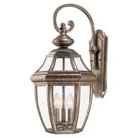 "Indoor/outdoor wall lantern in platinum.   Product: Wall lanternConstruction Material: Metal and glassColor: PlatinumFeatures: Suitable for indoor and outdoor useAccommodates: (3) 60 Watt C bulbs - not includedDimensions: 25"" H x 13"" W x 14.5"" D"