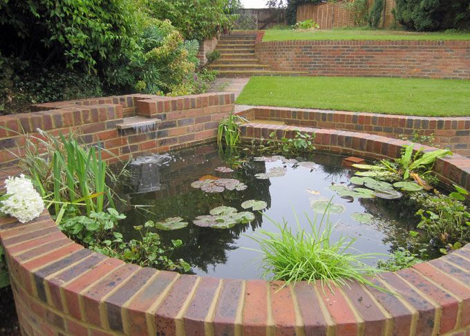 A raised pond is integrated into the garden structure for Raised pond design