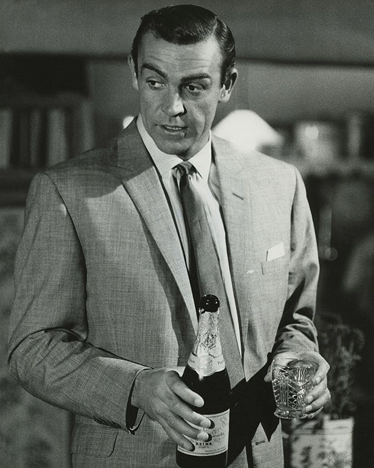 ab71d6404fb05 Sean Connery as James Bond in Guy Hamilton s Goldfinger (1964) enjoying his  favourite drink