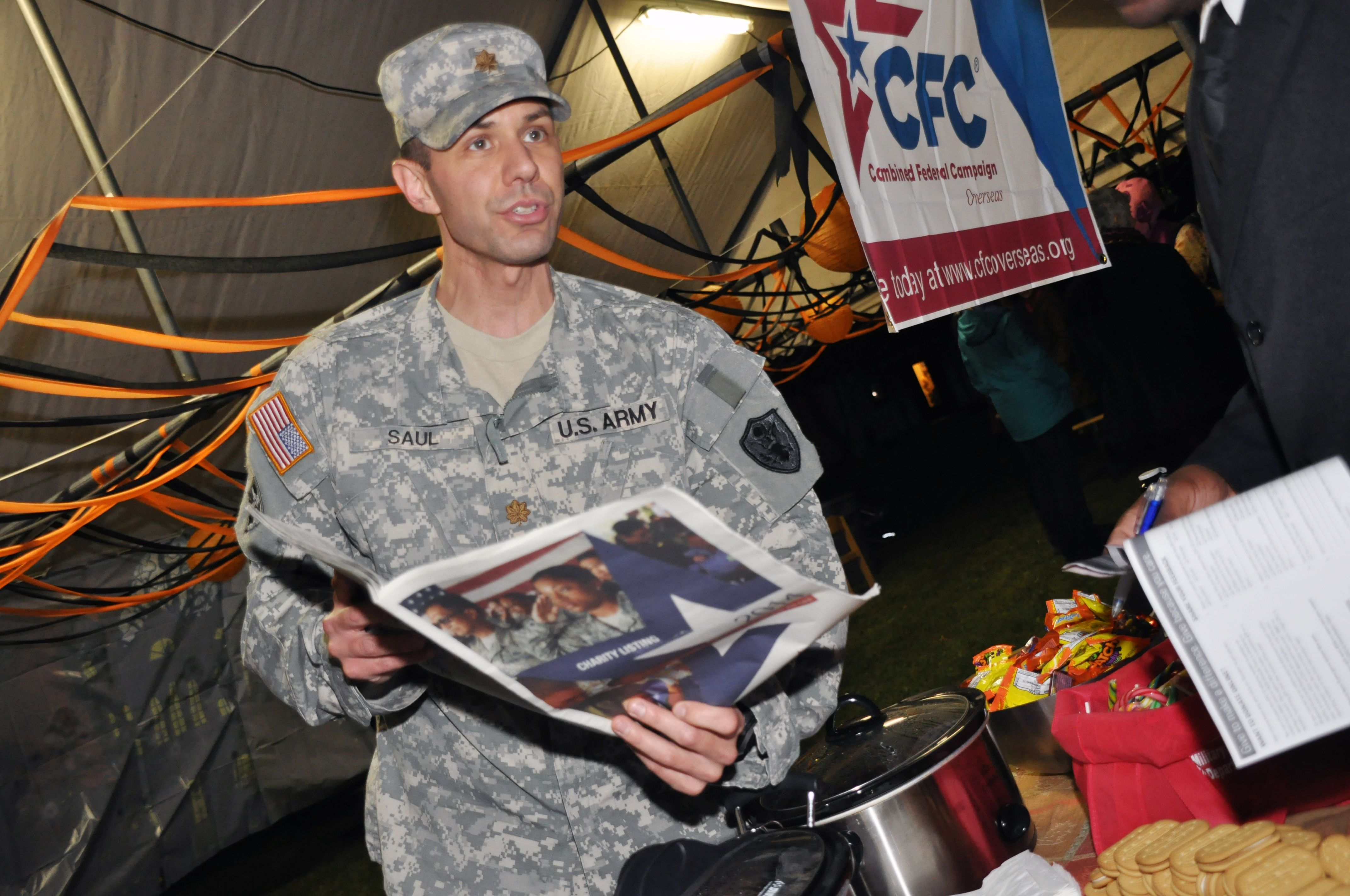 @Marshall_Center's @CFCOverseas campaign goes #trick-or-treating @USAGBavaria  U.S. Army Maj. Nathan Saul, CFC representative at the George C. Marshall European Center for Security Studies, hands out candy, cookies and hot chocolate while spreading the news about CFC during the Spooktacular Halloween event here Oct. 31. For more photos, go to https://www.flickr.com/photos/gcmcphotos/sets/72157649103247932/ (DOD photo by U.S. Army Sgt. Jason Edwards/RELEASED)