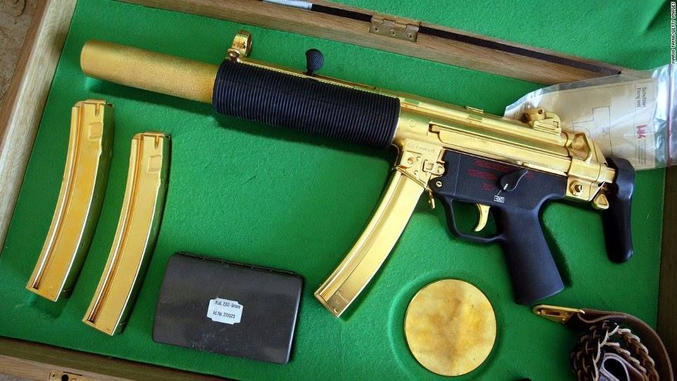 Saddam Hussein's gold-plated sub-machine gun | Ellcock