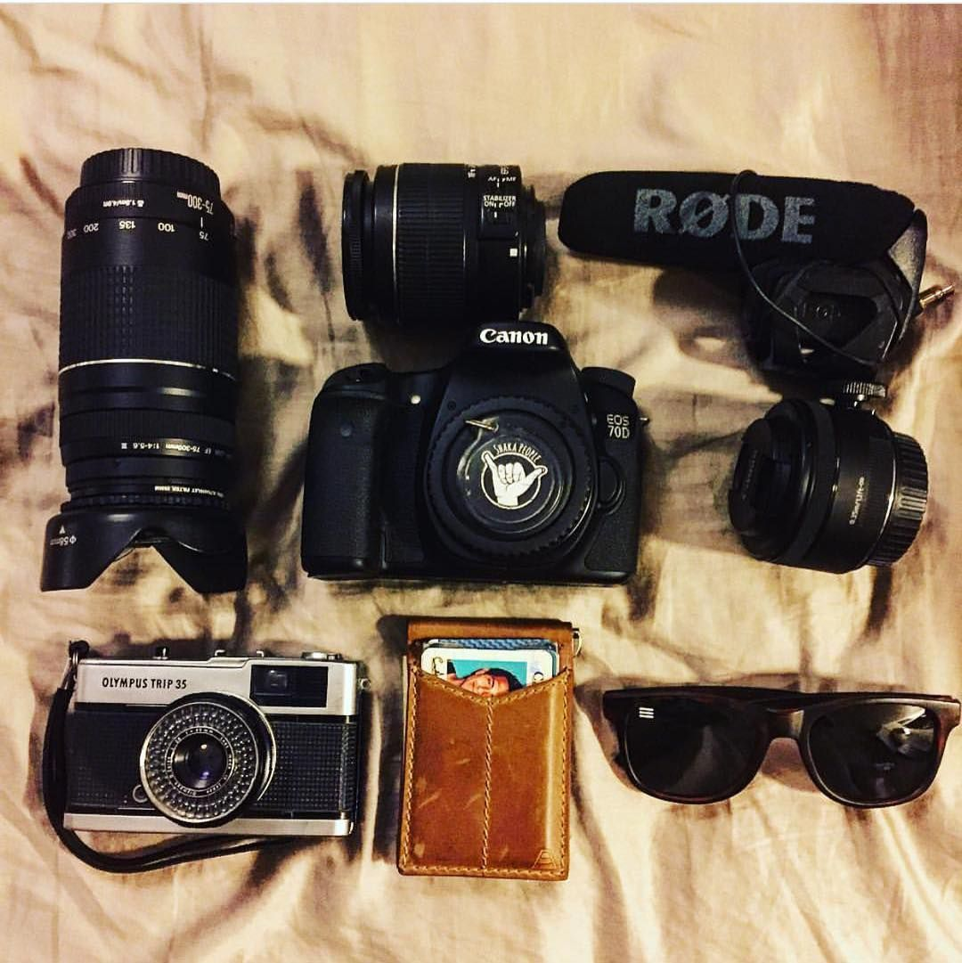 Camera  lenses  sunglasses  wallet  :@carlos_sanchez94