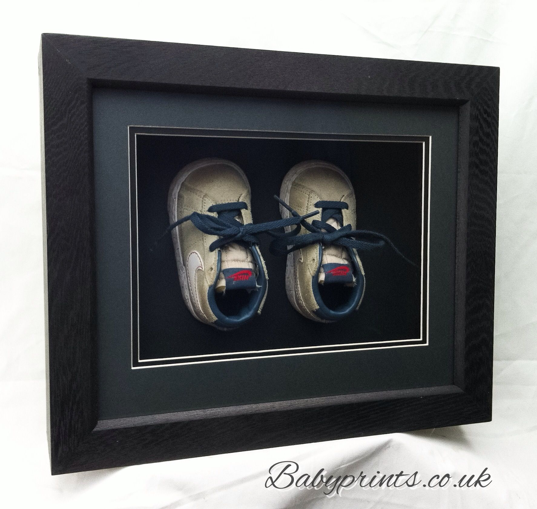 Your little boy's first shoes framed in our extra deep frames made especially.  By Babyprints.co.uk