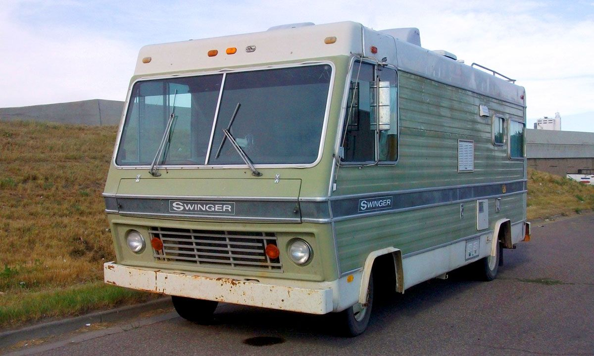 An Old Boxy Motorhome Green Paint On The Sides Large Front Windows