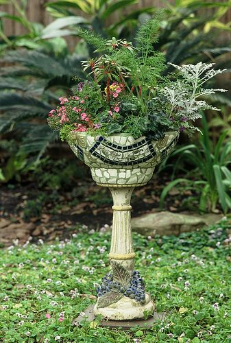 A mosaic piece that is garden perfect.