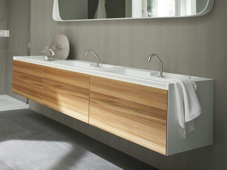 mueble bajo lavabo suspendido de corian con puertas