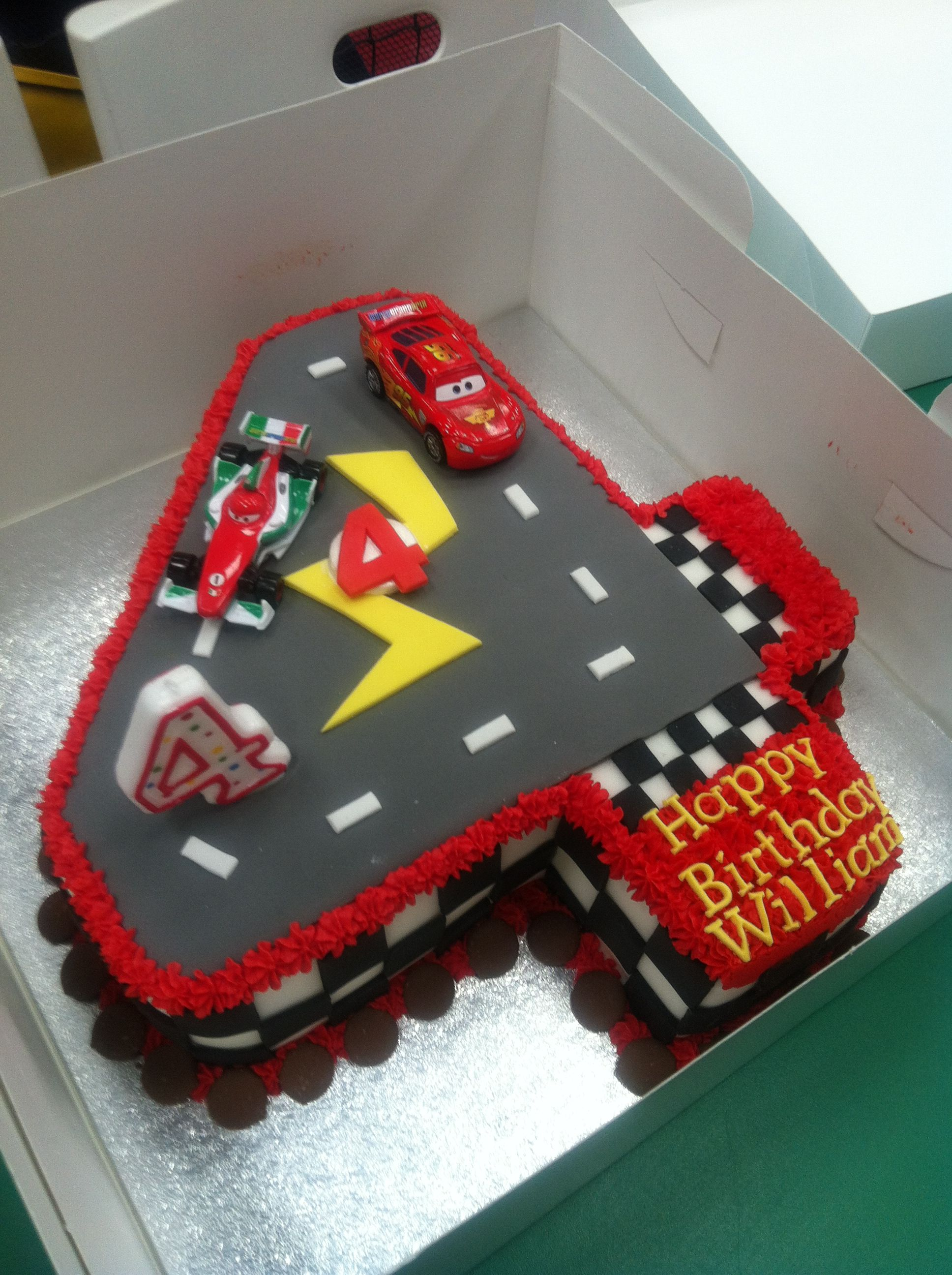 Lightning mcqueen cake car was made out of chocolate cake carved and covered with fondant custom cakes pinterest lightning mcqueen