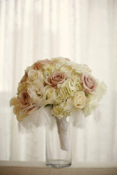 Bouquet: Hydrangea, roses, ostrich feathers, and a lace wrap.