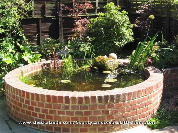 Raised brick built circular pond the ideal height is for Circular garden ponds