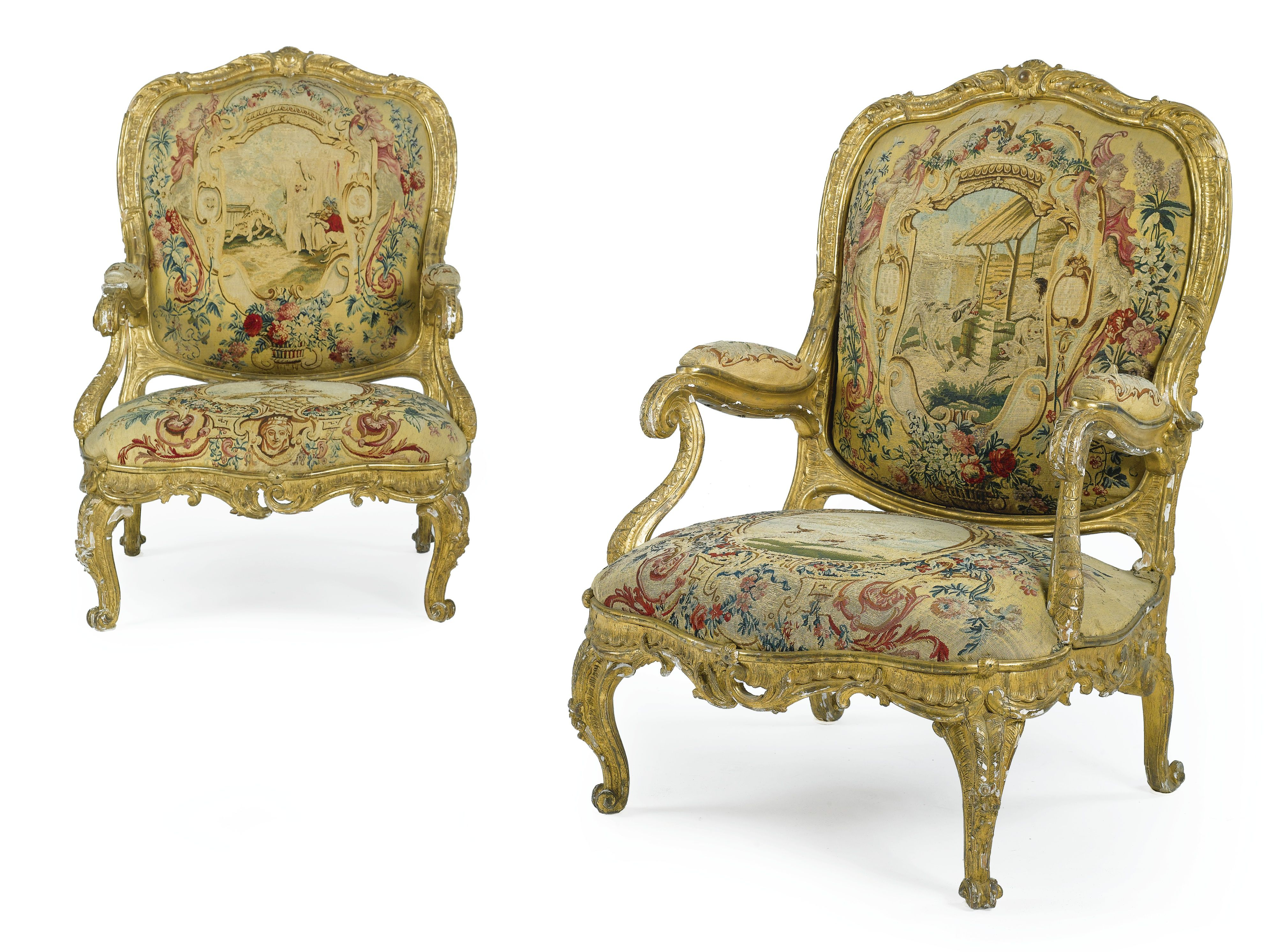 A pair of German Rococo carved giltwood armchairs upholstered