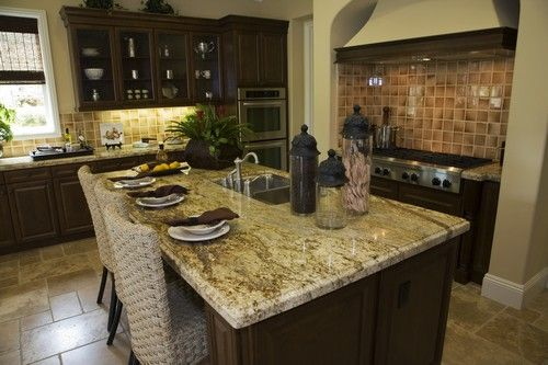 Dark Cabinets And Warm Granite In Earth Tones With Stainless Steel