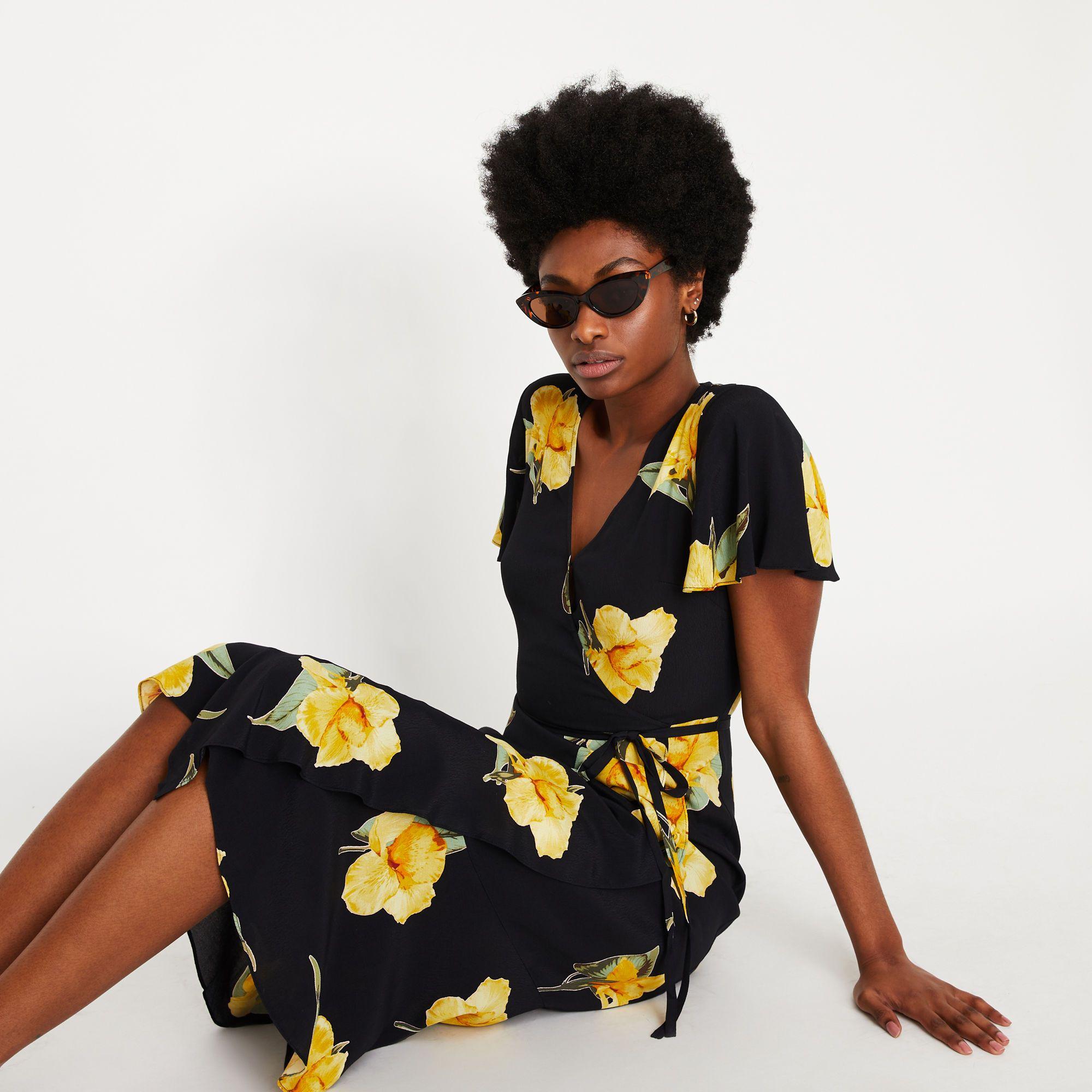 2388f4770b56 Yellow floral midi wrap dress in 2019