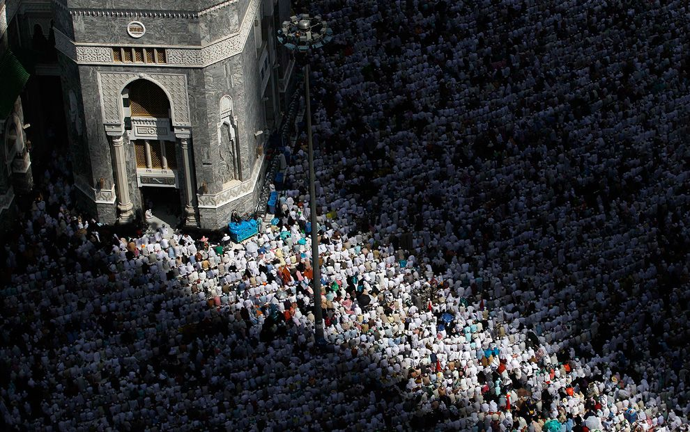 In shadows and sunlight, thousands of Muslim pilgrims pray inside the Grand Mosque in Mecca, Saudi Arabia