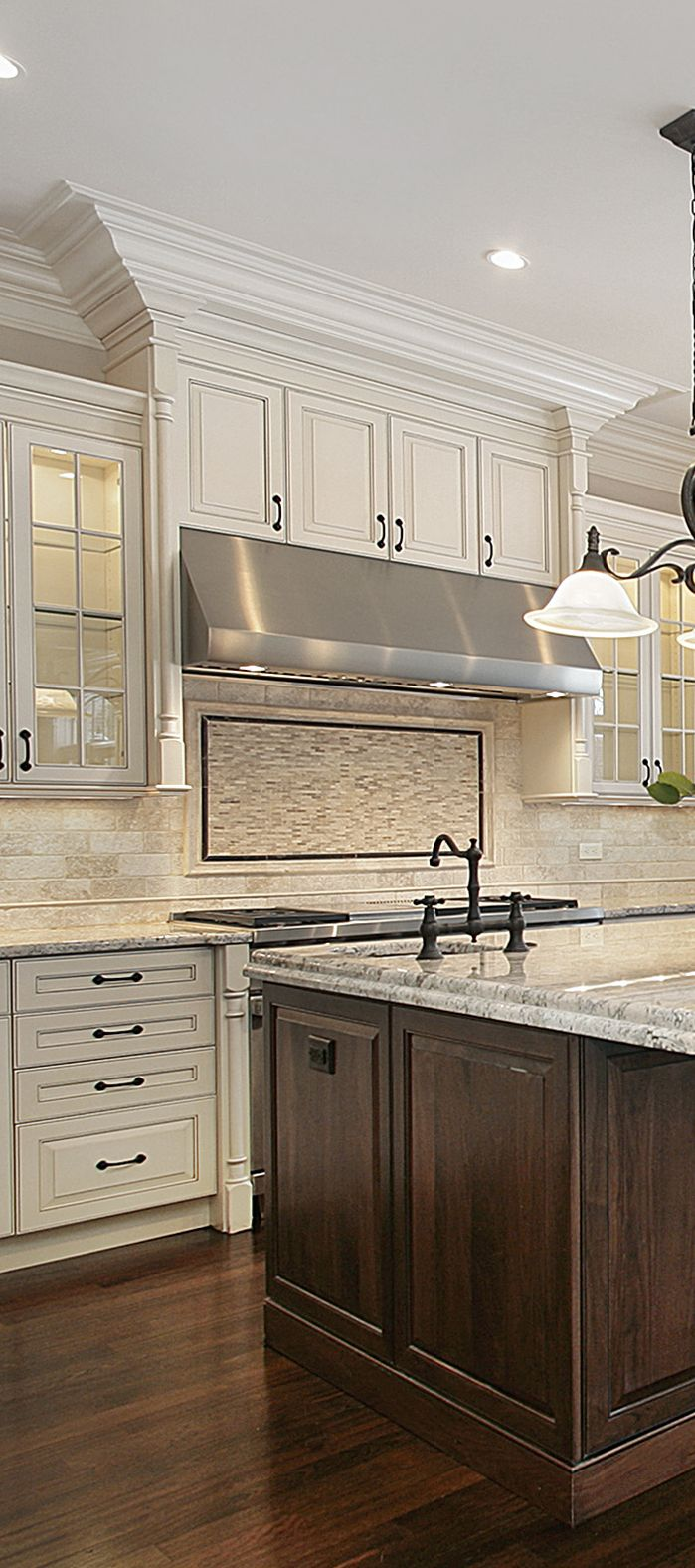 Off white kitchen with large stained wood island