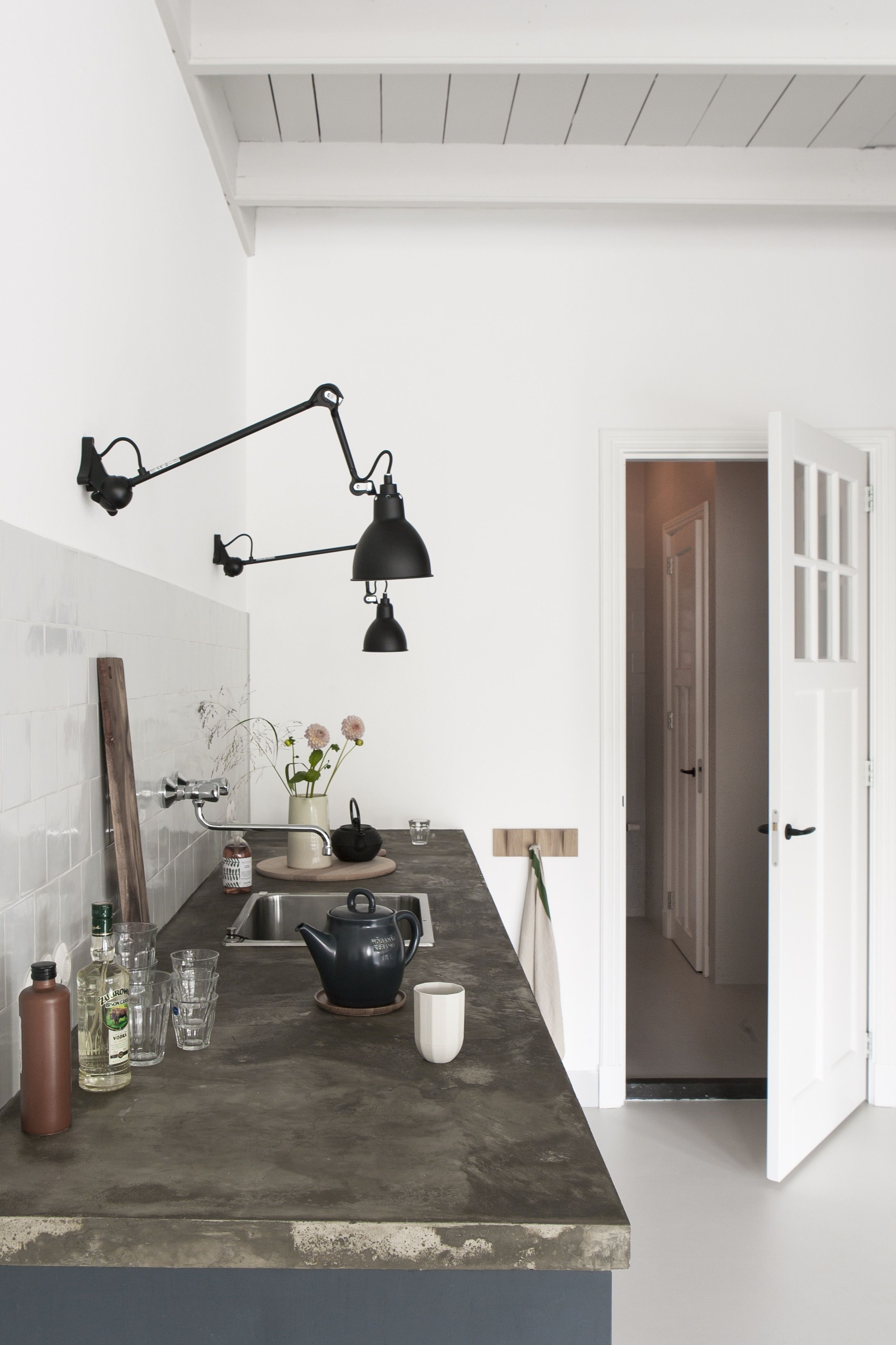 Dutch interior designer Christen Starkenburgu0027s Interieur-Plus workspace/ kitchen at Jan de Jong her familyu0027s design shop in Friesland the Netherlands | ... : kitchen wall lighting - hauntedcathouse.org