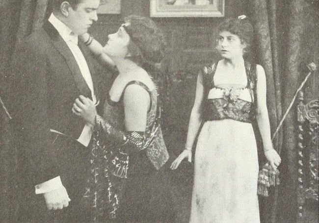 Richard C. Travers, Gloria Swanson, and Ruth Stonehouse in The Romance of an American Duchess (1915). I don't know if this, one of Gloria's earliest screen appearances, is extant or not. It was produced by the Essanay studio, located in Gloria's native city of Chicago. #romanceornot?
