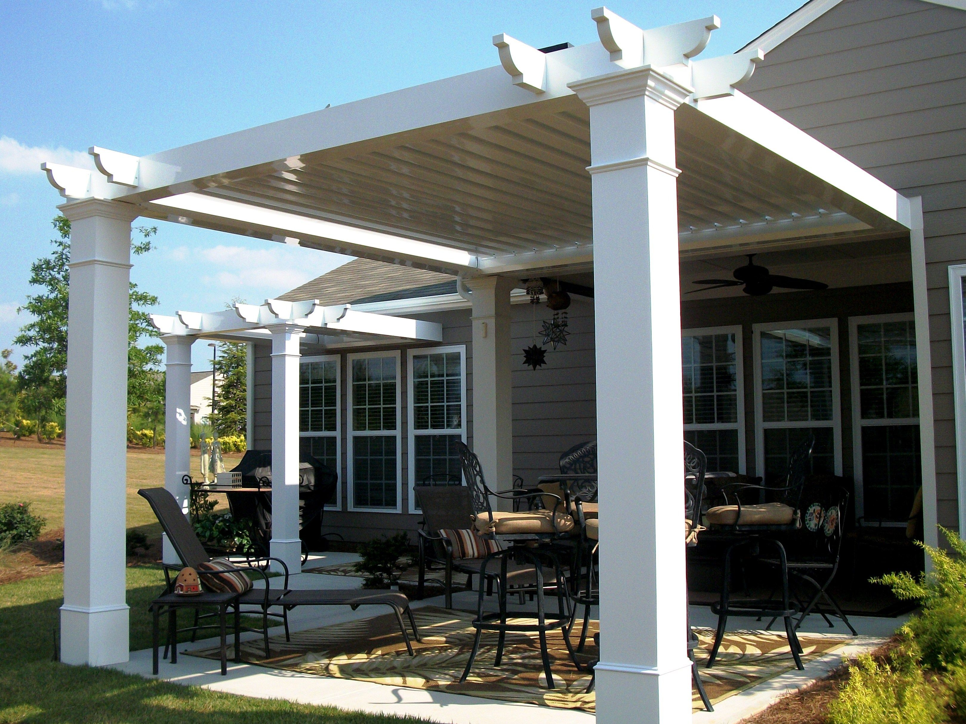 Adjustable pergola outdoor kitchens screen enclosures for Terrace roof ideas