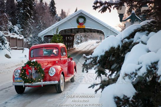 Red Vintage truck with Christmas tree