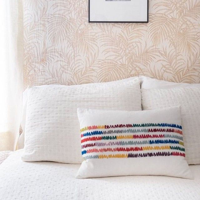 Coyuchi In A Apartment Therapy S House Tour Emmy Andreas Airy Attic Abode In Providence Featured Is Our Cozy Cotton Blanket Coyuchi Bed Pillows