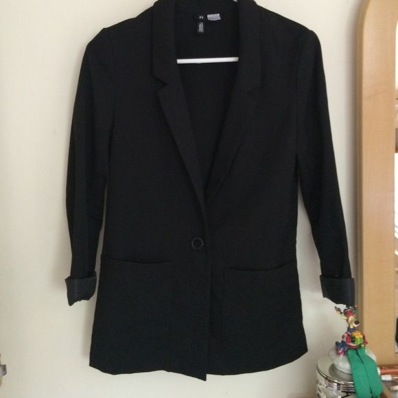 H&M Black Blazer NWOT. Never worn, no signs of wear. DIVIDED line. U.S. Size 4z 3/4 sleeve. Single button closure at front. Double pockets on each side. Rolled up cuffs on sleeves. Simple and versatile piece. Last pic shows fit and style, not exact blazer. H&M Jackets & Coats Blazers