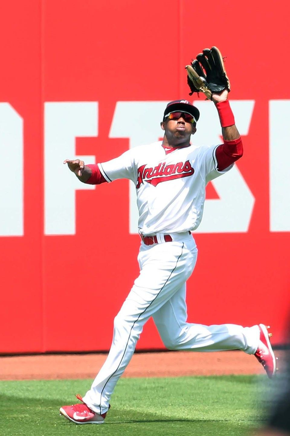 Cleveland Indians Greg Allen shags down the fly ball hit