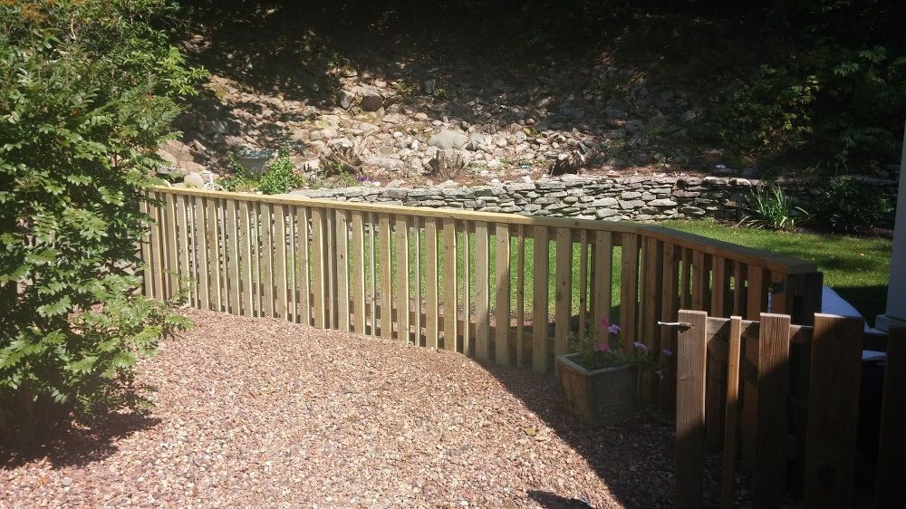 A homeowner has trouble keeping her neighbor's dog out of her backyard. See her clever solution: