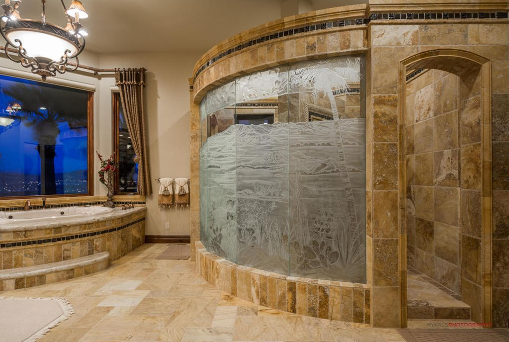 Mediterranean Master Bathroom with Americh Shell Jetted