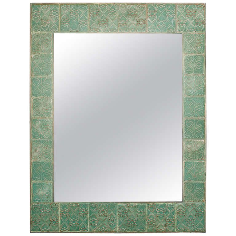 Mirror by Illums Bolighus   COUNTRY:Denmark DATE OF MANUFACTURE:1960s MATERIALS:Frame with ceramic tiles, edge and inner frame in brass.