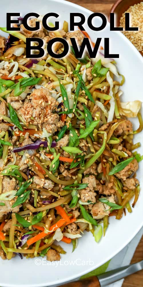 Egg Roll In A Bowl is a quick and easy one pot meal. Ground chicken or pork are cooked with fresh veggies, then tossed with a spicy sauce made of ginger, soy sauce and Sriracha. It has all the textures and flavors found inside a traditional egg roll without the calories! #easylowcarb #eggrollinabowl #eggroll #lowcarb #lowcarbdinner #lowcarbbowl #eggrollbowl #broccolislaw #keto #bestbowlrecipe #easybowlrecipe #asianinspired #eggrollinabowl