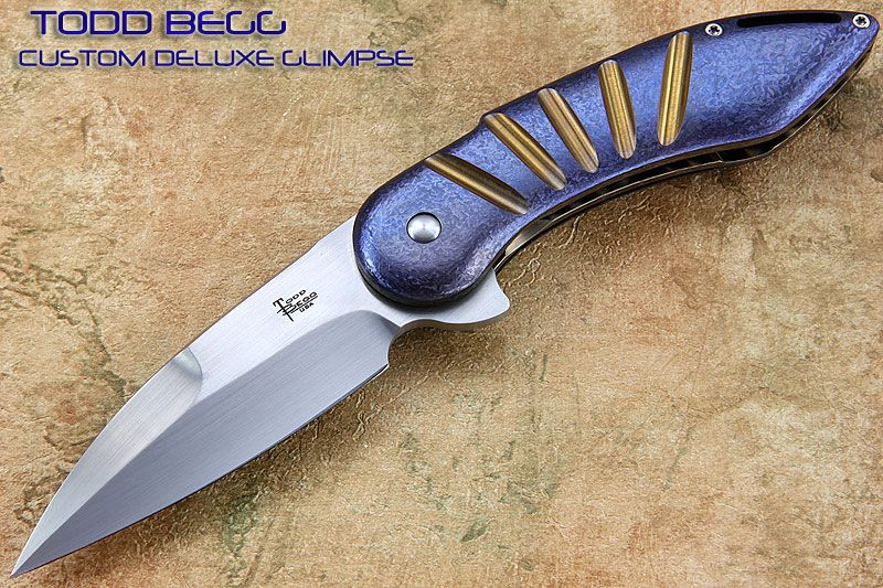 """TODD BEGG :DRESS GLIMPSE - CUSTOM MADE BY TODD. FLIPPER FOLDER. HAND RUBBED CPM 154 STAINLESS STEEL MODIFIED WHARNCLIFF FLAT GROUND BLADE. CRACKED ICE MACHINED TITANIUM HANDLE AND THICK LINERS. CRACKED ICE TITANIUM TITANIUM TIP UP POCKET CLIP AND BACKSTRAP. STAINLESS SCREWS AND 416 STAINLESS PIVOT. I.K.B.S. BEARING PIVOT :: SMOOTH DEPENDABLE SOLID ACTION. Blade Length: 3 3/4"""" Cutting edge: 3 1/2"""" Overall Length: 8 3/4"""" Closed Length: 5 1/8"""""""