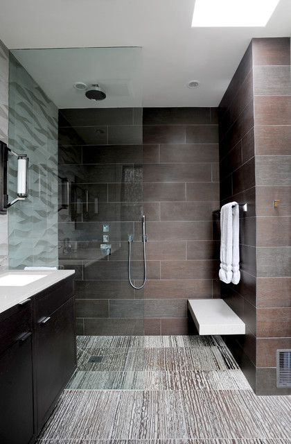 Images On Contemporary bathroom with curbless shower floor floating bench floating vanity mounted to a tiled wall and a full height fixed glass screen recessed into
