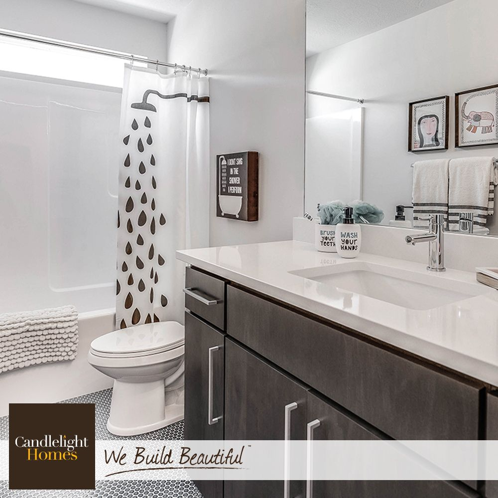 This black and white bath is showered in style! #CandlelightHomes ...