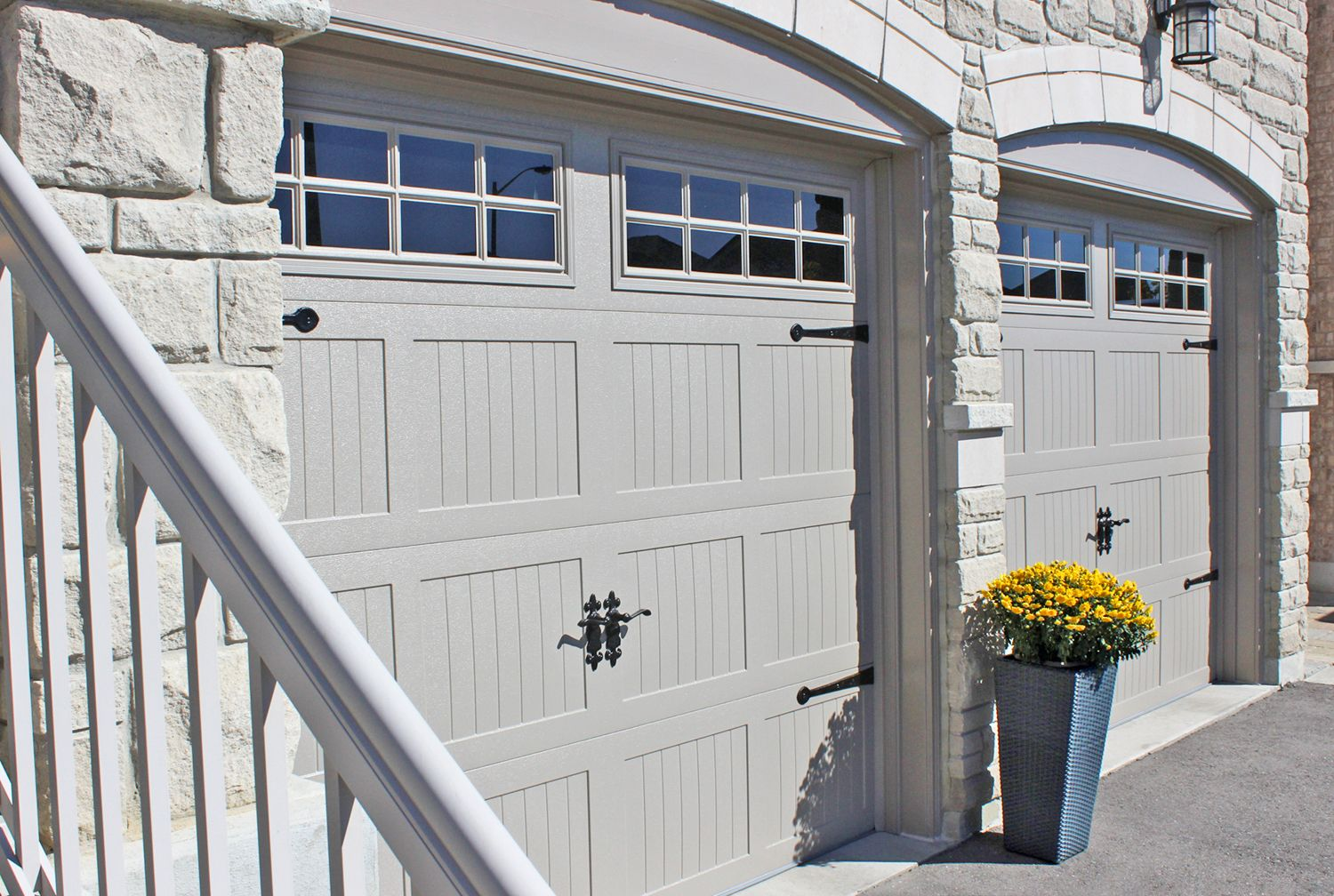 Chi Carriage House Garage Doors Sandstone Wrought Iron