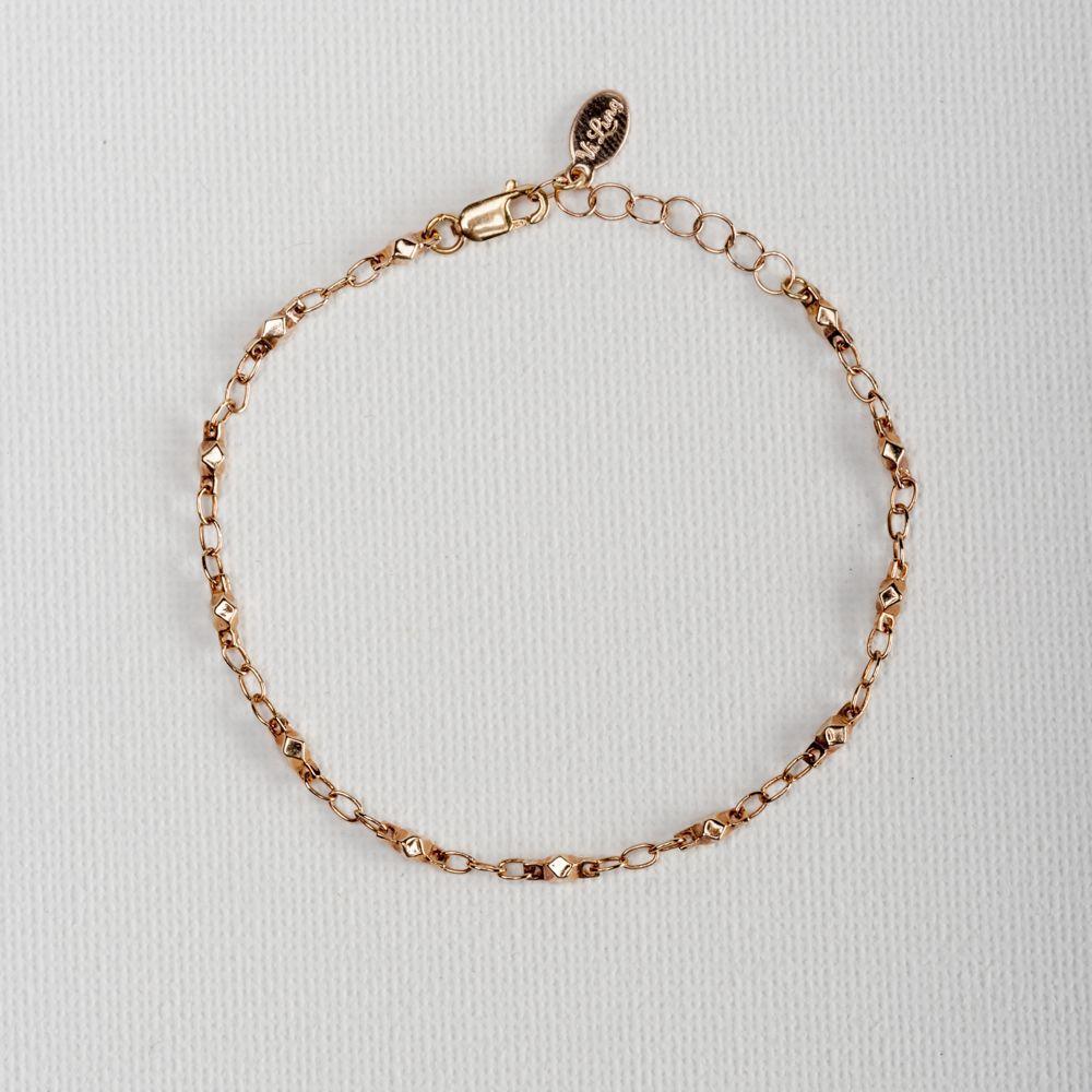 Elise Rose Gold  Bracelet Simple yet elegant chain detailed 14k rose gold filleddiamond cut nuggets connecting beads.   #Vilingdesigns #daintyjewelry #bracelets #womensfashion #style #jewelry #gold #armcandy
