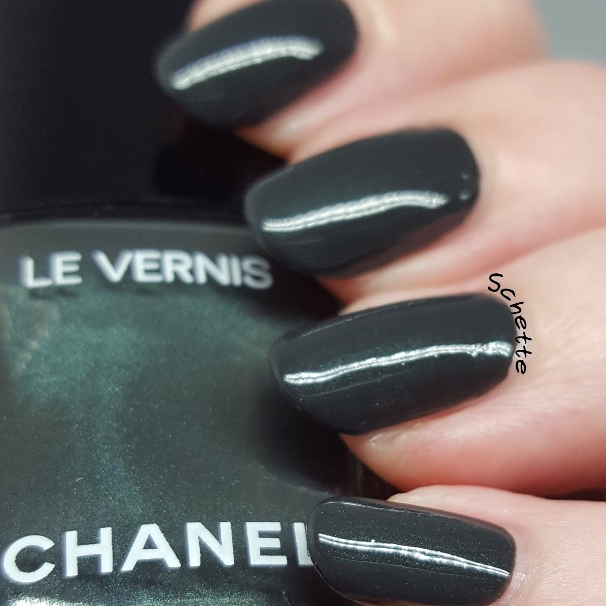 This dark green with green shimmer is called Sargasso by Chanel ...