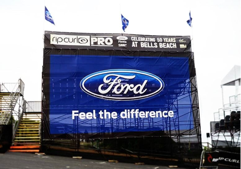 Vinyl mesh banner with reinforced eyelets on a portable grandstand.