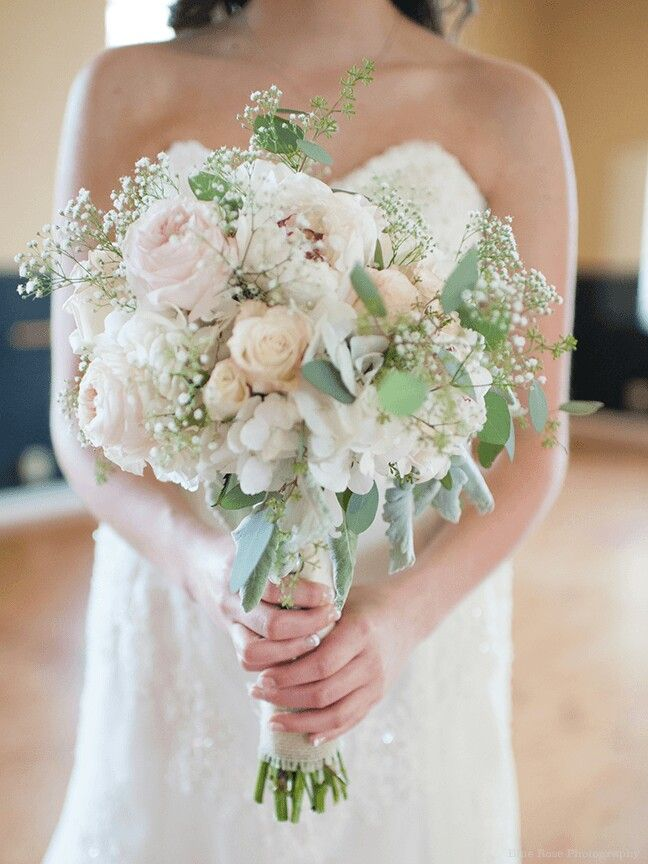 neutral wedding bouquet arranged with peonies hydrangea garden roses roses dusty