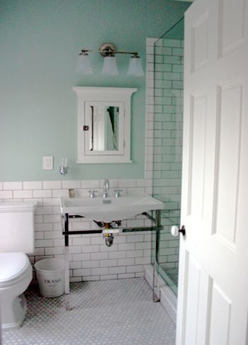 love the half wall of subway tile and how it extends to the shower