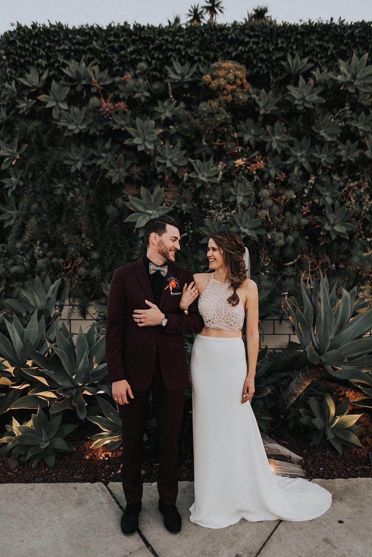 Heartfelt bohemian wedding with earth tones desert plants beaded